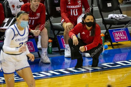 Nebraska head coach Amy Williams on the sideline watching the game action against Creighton during an NCAA college basketball game, in Omaha, Neb