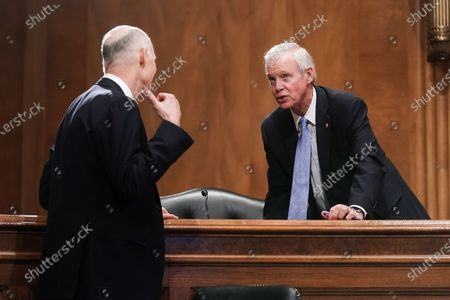 Sen. Rick Scott (R-Fla.) talks to Senate Homeland Security and Governmental Affairs Committee Chairman Ron Johnson (R-Wis.) during a Senate Homeland Security & Governmental Affairs Committee hearing to examine baseless claims of voter irregularities in the 2020 election in the Dirksen Senate Office Building in Washington, DC, USA, 16 December 2020. US President Donald J. Trump continues to push baseless claims of voter fraud over the presidential election, which the Department of Homeland Security called 'the most secure in American history.'