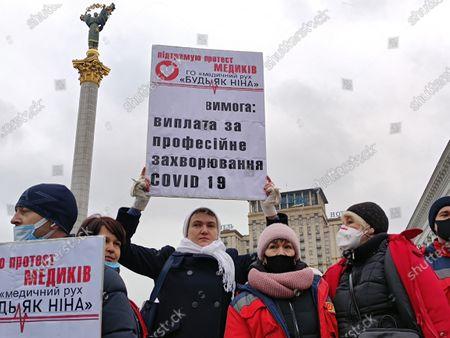 Ukrainian politician Nadiya Savchenko (C) joins the protest action of healthcare workers demanding funding of medicine in the State Budget for 2021 in Maidan Nezalezhnosti, Kyiv, capital of Ukraine.