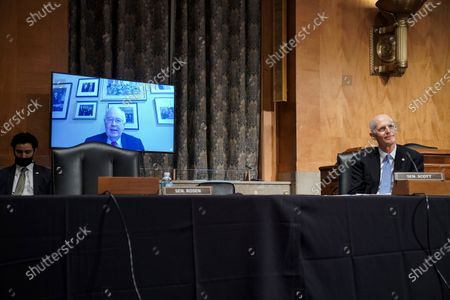 Attorney Kenneth Starr remotely answers a question by Sen. Rick Scott, R-Fla., during a Senate Homeland Security & Governmental Affairs Committee hearing to discuss election security and the 2020 election process, on Capitol Hill in Washington