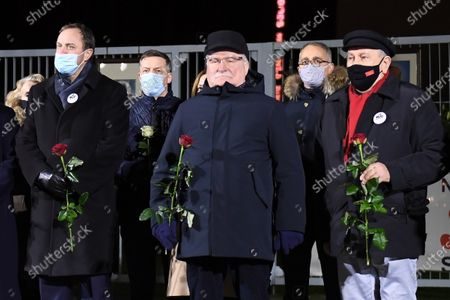 Former Polish President and leader of the Independent Polish Trade Union Solidarity, Nobel Peace Prize laureate Lech Walesa (C) attends the ceremony of lighting candles and laying flowers at the Gate No 2 of the Gdansk Shipyard in Gdansk, northern Poland, 16 December 2020. Ceremonies are held to observances marking the 50th anniversary of the tragic anti-communist protests of December 1970.