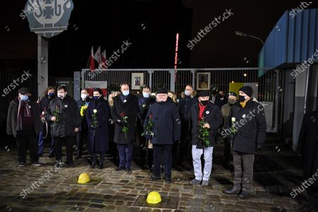 Former Polish President and leader of the Independent Polish Trade Union Solidarity, Nobel Peace Prize laureate Lech Walesa (3R) attends the ceremony of lighting candles and laying flowers at the Gate No 2 of the Gdansk Shipyard in Gdansk, northern Poland, 16 December 2020. Ceremonies are held to observances marking the 50th anniversary of the tragic anti-communist protests of December 1970.