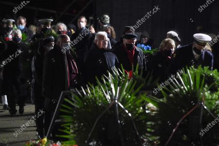 Former Polish President and leader of the Independent Polish Trade Union Solidarity, Nobel Peace Prize laureate Lech Walesa (C) attends the ceremony of lighting candles and laying flowers at the Monument to the Fallen Shipyard Workers in Gdansk, northern Poland, 16 December 2020. Ceremonies are held to observances marking the 50th anniversary of the tragic anti-communist protests of December 1970.
