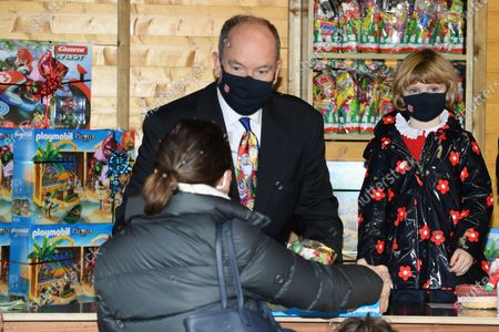 Prince Albert II of Monaco and Princess Gabriella of Monaco attend the Christmas gift distribution