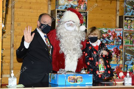 Stock Image of Prince Albert II of Monaco and Princess Gabriella of Monaco attend the Christmas gift distribution