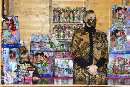 Princess Charlene of Monaco attends the Christmas gift distribution
