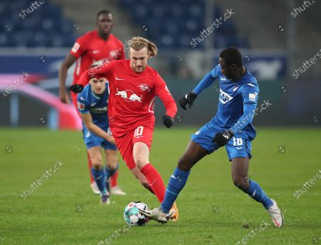 Emil Forsberg of RB Leipzig and Diadie Samassekou of TSG 1899 Hoffenheim battle for the ball  during the Bundesliga match between TSG Hoffenheim and RB Leipzig at PreZero-Arena in Sinsheim, Germany, 16 December 2020.