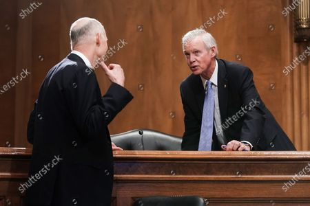 United States Senator Rick Scott (Republican of Florida) talks to US Senator Ron Johnson (Republican of Wisconsin), Chairman, US Senate Committee on Homeland Security and Government Affairs during a hearing to discuss election security and the 2020 election process.