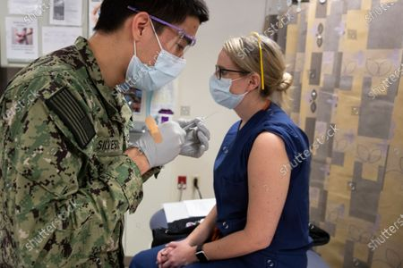 Editorial picture of Pfizer-BioNTech COVID-19 vaccine is administered at Naval Medical Center Portsmouth (NMCP) in Portsmouth, Virginia, USA - 16 Dec 2020