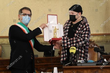 Stock Photo of Mayor, Virginio Merola and Councilor for Culture, Matteo Lepore awards the Golden Neptune honor of the Municipality of Bologna to Vasco Rossi