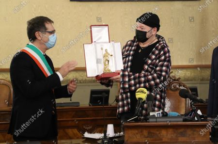 Mayor, Virginio Merola and Councilor for Culture, Matteo Lepore awards the Golden Neptune honor of the Municipality of Bologna to Vasco Rossi