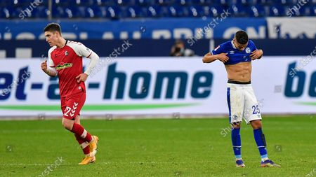 Schalke's Amine Harit, right, reacts after Freiburg's Roland Sallai, left, scored the second goal during the German Bundesliga soccer match between FC Schalke 04 and SC Freiburg at the Arena in Gelsenkirchen, Germany