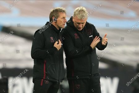 West Ham manager David Moyes (R) listens to assistant manager Stuart Pearce (L) during the English Premier League soccer match between West Ham United and Crystal Palace, in London, Britain, 16 December 2020.