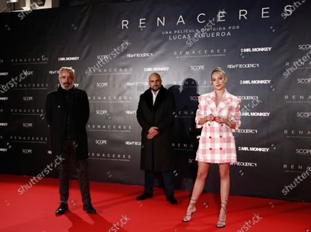 Argentinian filmaker Lucas Figueroa (C), Spanish actor Imanol Arias (L) and Spanish actress Ester Exposito (R) pose for the media during the preview of the documentary 'Renaceres' in Madrid, Spain, 16 December 2020.