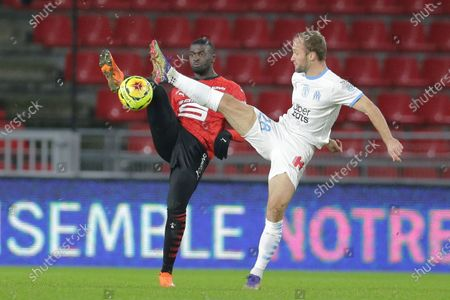Stock Photo of Rennes' forward Mbaye Niang, left, challenges for the ball with Marseille's forward Valere Germain, right, during the League One soccer match between Rennes and Marseille, at the Roazhon Park stadium in Rennes, France