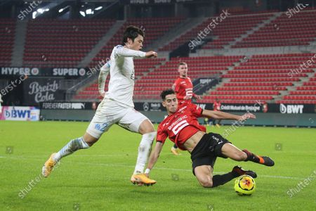 Marseille's Japanese defender Hiroki Sakai, left, competes for the ball with Rennes' defender Nayef Aguerd during the League One soccer match between Rennes and Marseille, at the Roazhon Park stadium in Rennes, France