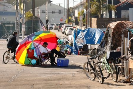 Editorial photo of The story is a wrap-up of the 20 homeless shelters Garcetti has established. It focuses on their record in getting people into housing and on Garcetti's promise to maintain clean streets around them. We've picked out three for photos. This assignment cover
