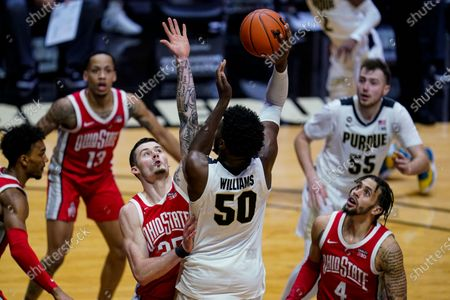 Purdue forward Trevion Williams (50) shoots over Ohio State forward Kyle Young (25) during the second half of an NCAA college basketball game in West Lafayette, Ind