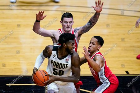 Purdue forward Trevion Williams (50) is defended by Ohio State guard CJ Walker (13) and forward Kyle Young (25) during the second half of an NCAA college basketball game in West Lafayette, Ind