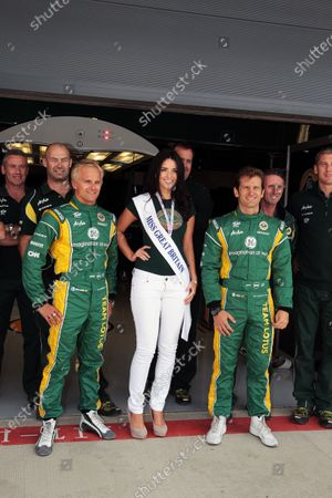 Stock Photo of (L to R): Heikki Kovalainen (FIN) Team Lotus, Amy Carrier (GBR) Miss Great Britain 2010, and Jarno Trulli (ITA) Team Lotus. Formula One World Championship, Rd 9, British Grand Prix, Preparations, Silverstone, England, Thursday 7 July 2011.