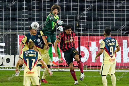 Club America goalkeeper Guillermo Ochoa, top center, blocks a shot on goal by Atlanta United during the first half of a CONCACAF Champions League soccer match, in Orlando, Fla