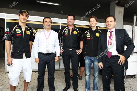 (L to R): Bruno Senna (BRA) Lotus Renault GP; Carlos Ghosn (FRA) Chairman of Renault; Eric Boullier (FRA) Lotus Renault GP Team Principal; Roman Grosjean (FRA) DAMS with Eric Besson (FRA) French Minister of Industry. Formula One World Championship, Rd 17, Indian Grand Prix, Buddh International Circuit, Greater Noida, New Delhi, India, Race Day, Sunday 30 October 2011.   BEST IMAGE