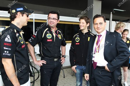 (L to R): Bruno Senna (BRA) Lotus Renault GP with Eric Boullier (FRA) Lotus Renault GP Team Principal and Romain Grosjean (FRA) Lotus Renault GP Third Driver with Eric Besson (FRA) French Minister of Industry. Formula One World Championship, Rd 17, Indian Grand Prix, Buddh International Circuit, Greater Noida, New Delhi, India, Race Day, Sunday 30 October 2011.