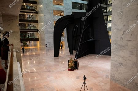 Stock Photo of U.S. Senator Lamar Alexander (R-TN) playing Christmas songs on a piano in the atrium of the Hart Senate Office Building.