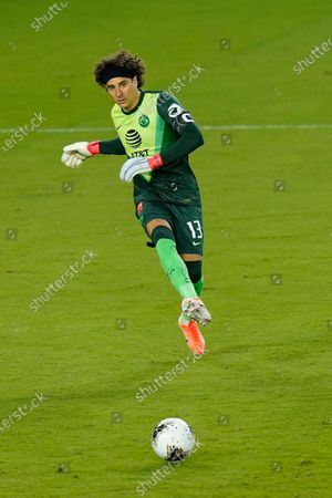 Club America goalkeeper Guillermo Ochoa (13) passes the ball to a teammate during the second half of a CONCACAF Champions League soccer match against Atlanta United, in Orlando, Fla