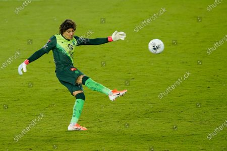 Club America goalkeeper Guillermo Ochoa (13) clears the ball during the second half of a CONCACAF Champions League soccer match against Atlanta United, in Orlando, Fla