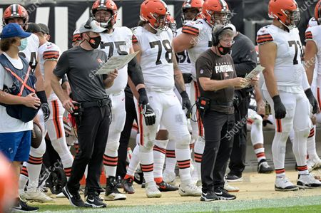 Stock Picture of Cleveland Browns head coach Kevin Stefanski, left, and offensive line coach Bill Callahan work from the sideline during the second half of an NFL football game against the Jacksonville Jaguars, in Jacksonville, Fla