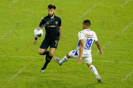 Los Angeles FC forward Diego Rossi (9) tries to control a pass in front of Cruz Azul midfielder Yoshimar Yotun (19) during the first half of a CONCACAF Champions League soccer match, in Orlando, Fla