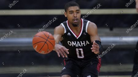 Stock Image of Omaha guard Sam'i Roe (0) in the first half of an NCAA college basketball game, in Boulder, Colo