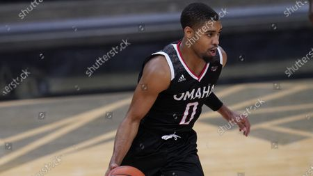 Omaha guard Sam'i Roe (0) in the first half of an NCAA college basketball game, in Boulder, Colo