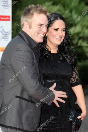 (L to R): Donal MacIntyre (IRE) TV presenter with his wife Ameera De La Rosa. Red Carpet Arrivals, Great Ormond Street F1 Party, Natural History Museum, London, 6 July 2011.