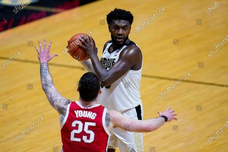 Purdue forward Trevion Williams (50) plays against Ohio State forward Kyle Young (25) during the second half of an NCAA college basketball game in West Lafayette, Ind