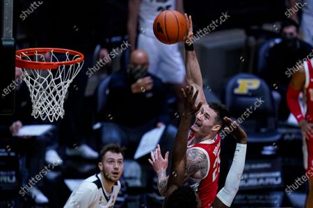 Ohio State forward Kyle Young (25) shoots over Purdue forward Trevion Williams (50) during the first half of an NCAA college basketball game in West Lafayette, Ind