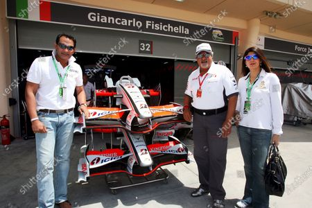Stock Photo of Dr. Vijay Mallya (IND) Force India F1 Team Owner with Mohammad Azharuddin (IND) Former Indian Cricket Captain (Left) and his wife Sangeeta Bijlani (IND) Bollywood Actress (Right). Formula One World Championship, Rd 3, Bahrain Grand Prix, Qualifying Day, Bahrain International Circuit, Bahrain, Saturday 5 April 2008.
