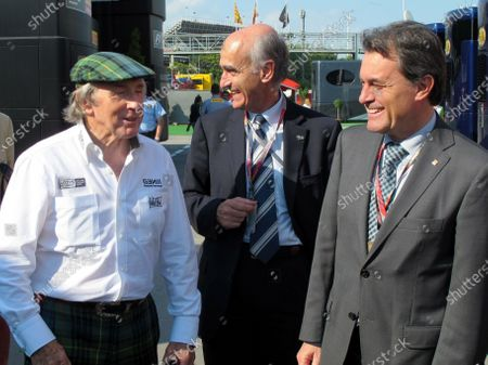 (L to R): Jackie Stewart (GBR) talks with Vicens Aguilera (ESP) President of the Spanish GP Consortium and Eric Besson (FRA) French Minister of Industry. Formula One World Championship, Rd 5, Spanish Grand Prix, Race Day, Barcelona, Spain, Sunday 22 May 2011.