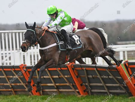 Stock Image of Emir Sacree (Joe Anderson) takes the last before going on to win The ITV7 £100K Jackpot On Boxing Day Conditional Jockeys Handicap Hurdle Race.