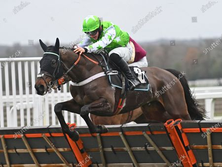 Stock Photo of Emir Sacree (Joe Anderson) takes the last before going on to win The ITV7 £100K Jackpot On Boxing Day Conditional Jockeys Handicap Hurdle Race.