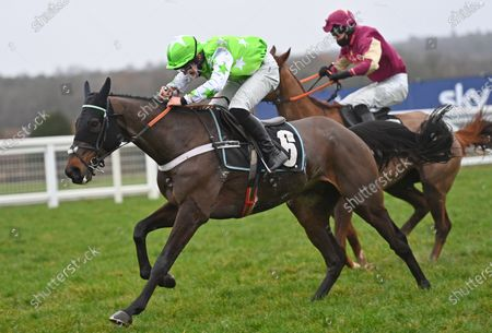 (L) Emir Sacree (Joe Anderson) after taking the last and before going on to win The ITV7 £100K Jackpot On Boxing Day Conditional Jockeys Handicap Hurdle Race from (R) Castle Robin (Paul OBrien).