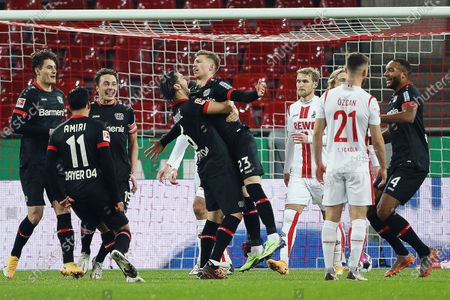 Mitchell Weiser(5th L) of Leverkusen celebrates scoring with his teammates during a German Bundesliga football match between FC Cologne and Bayer 04 Leverkusen in Cologne, Germany, Dec. 16, 2020.