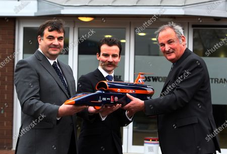 L-R: Tim Routsis (GBR), CEO of Cosworth Group Holdings Ltd (CGHL); Daniel Jubb (GBR), CEO of The Falcon Project Ltd; Richard Noble (GBR), Bloodhound Project Director. Bloodhound to test fire Britain's biggest hybrid rocket, Cosworth, Northampton, England, 3 March 2011.