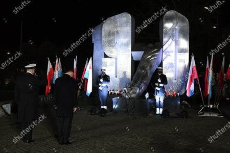 Polish President Andrzej Duda (2L) attends a wreath laying ceremony marking 50th anniversary of the December 1970 worker protests in Gdynia, north Poland, 17 December 2020.