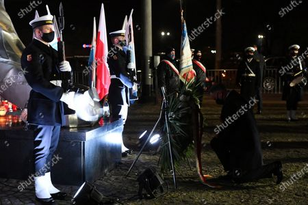 Polish President Andrzej Duda (R) attends a wreath laying ceremony marking 50th anniversary of the December 1970 worker protests in Gdynia, north Poland, 17 December 2020.