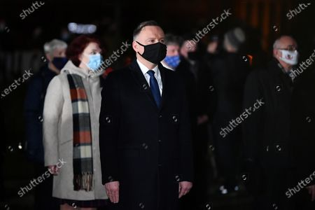 Polish President Andrzej Duda (C) attends a wreath laying ceremony marking 50th anniversary of the December 1970 worker protests in Gdynia, north Poland, 17 December 2020.