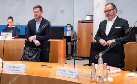 Former German Economics and Technology Minister Karl-Theodor zu Guttenberg (L) and his lawyer Christian Schertz attend a meeting of the 3rd Wirecard investigation committee at Paul-Loebe-Haus in Berlin, 17 December 2020.