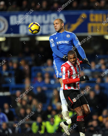 Alex Rodrigo Dias da Costa  of Chelsea wins a header from Darren Bent of Sunderland