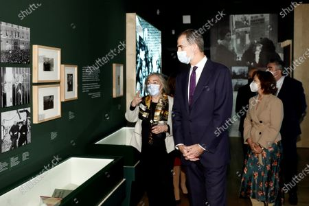 Spain's King Felipe VI (C) attends the opening of an exhibition to mark the 80th anniversary of the death of Spanish late President of the Spanish Second Republic Manuel Azana at the National Library, in Madrid, Spain, 17 December 2020, together with Spanish First Deputy Prime Minister, Carmen Calvo (R).